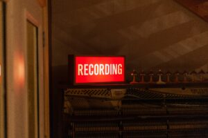 Red illuminated recording sign